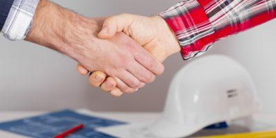close-up-men-shaking-hands_23-2148384540