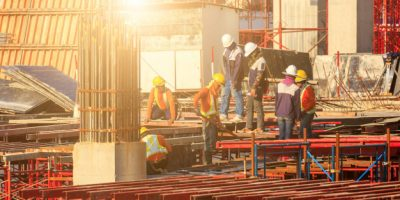 laborers-working-modern-constraction-site-works-bangkok-thailand_38810-3156